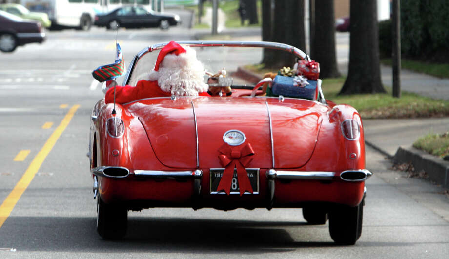 Santa, otherwise known as Don Ward of Virginia Beach, Va., drives down Princess Anne Avenue in his 1958 Corvette on Christmas Eve, Saturday, Dec. 24, 2011. Photo: Steve Earley, Associated Press / Copyright 2008, The Virginian-Pilot