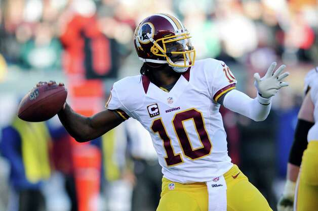 FILE - In this Dec. 23, 2012, file photo, Washington Redskins' Robert Griffin III throws a pass during the second half of an NFL football game against the Philadelphia Eagles in Philadelphia. Griffin was selected to the Pro Bowl on Wednesday, Dec. 26, 2012. (AP Photo/Michael Perez, File) Photo: Michael Perez, Associated Press / FR168006 AP