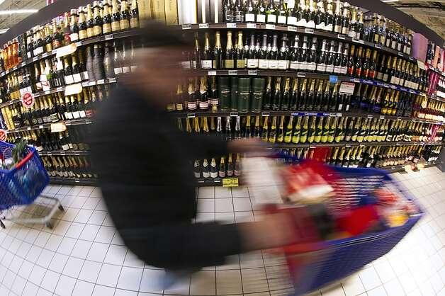 Left: Champagne is plentiful on supermarket shelves in Montesson, France. Sales in Europe fizzled in 2012. Photo: Lionel Bonaventure, AFP/Getty Images