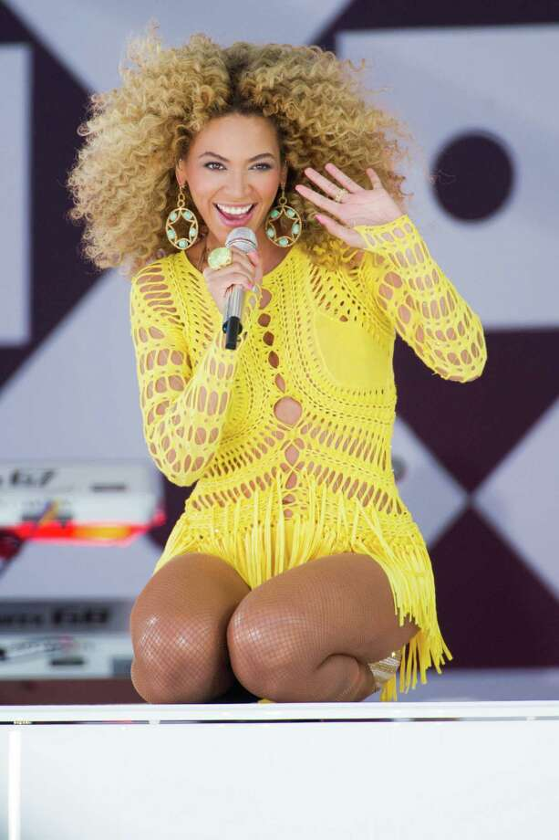 "FILE - In this July 1, 2011 file photo, Beyonce performs on ABC's ""Good Morning America"" in New York. Through a photo contest, 100 fans will join Beyonce onstage during the singer's halftime show performance at the 2013 Super Bowl on Feb. 3, 2013, at the Mercedes-Benz Superdome in New Orleans. (AP Photo/Charles Sykes, File) Photo: Charles Sykes"