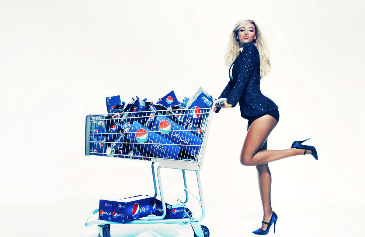 This Oct. 23, 2012 publicity photo provided by Pepsi shows Beyonce during a Pepsi Print photo shoot at Canoe Studios in New York. This image will appear as life-size standees in stores starting first quarter 2013, as an extension of the brand?'s ?