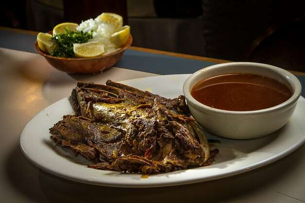 Birria is served weekends and offers pleasantly gamey pieces of lamb, piquant broth and garnishes of diced onions, cilantro, dried oregano, crushed chiles and lime. Photo: John Storey, Special To The Chronicle