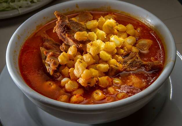 The pork and hominy-rich posole, above, is among the favorites at Gallardo's on the Mission-SoMa border in San Francisco. Birria, far right, is served weekends and offers pleasantly gamey pieces of lamb, piquant broth and garnishes of diced onions, cilantro, dried oregano, crushed chiles and lime. Photo: John Storey, Special To The Chronicle