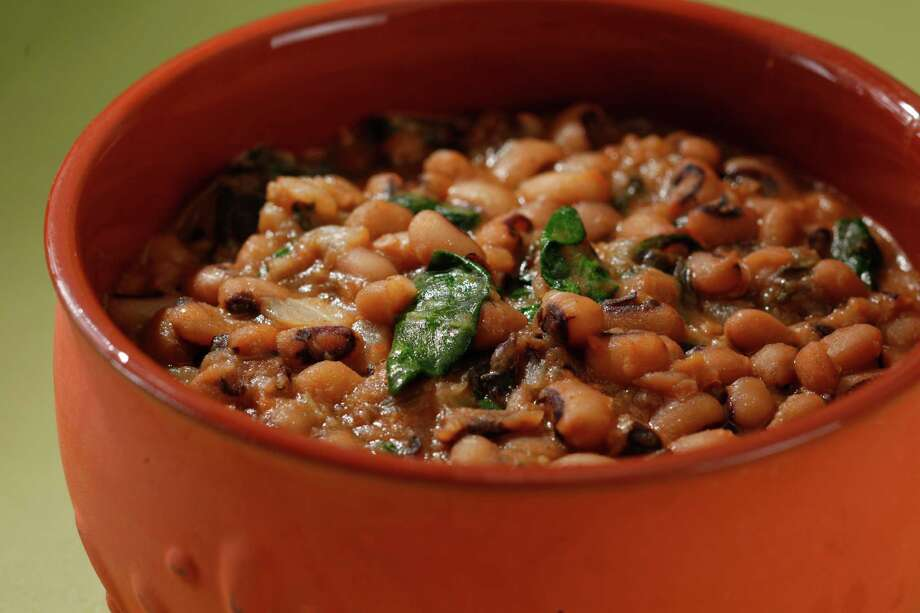 Many people in the South believe a new year must be ushered in with black-eyed peas. This black-eyed peas stew with cretan mixed greens might bring favors in 2013. Food styled by Simon F. F. Young. Photo: Craig Lee, Special To The Chronicle / ONLINE_YES