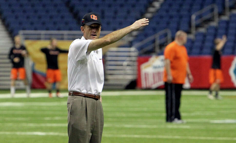 Oregon State head coach Mike Riley waves to players to commence a walk-through practice at the Alamodome for their game against the University of Texas in the Valero AlamoBowl on Friday, Dec. 28, 2012. Photo: Kin Man Hui, San Antonio Express-News / © 2012 San Antonio Express-News