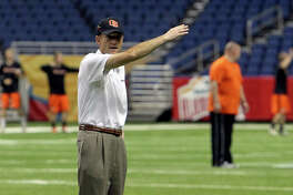 Oregon State head coach Mike Riley waves to players to commence a walk-through practice at the Alamodome for their game against the University of Texas in the Valero AlamoBowl on Friday, Dec. 28, 2012.
