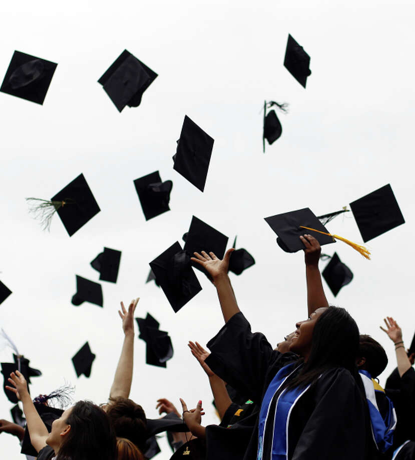 In this May 20, 2011, file photo, graduates from various institutions toss their hats in the air in Philadelphia. Many graduatues are burried in student loans, but Joe Mihalic, a  business school graduate paid off $90k in student loans in 7 months and blogged about his experience at NoMoreHarvardDebt.com. (AP Photo/Matt Rourke, File) Photo: Matt Rourke / Associated Press / AP