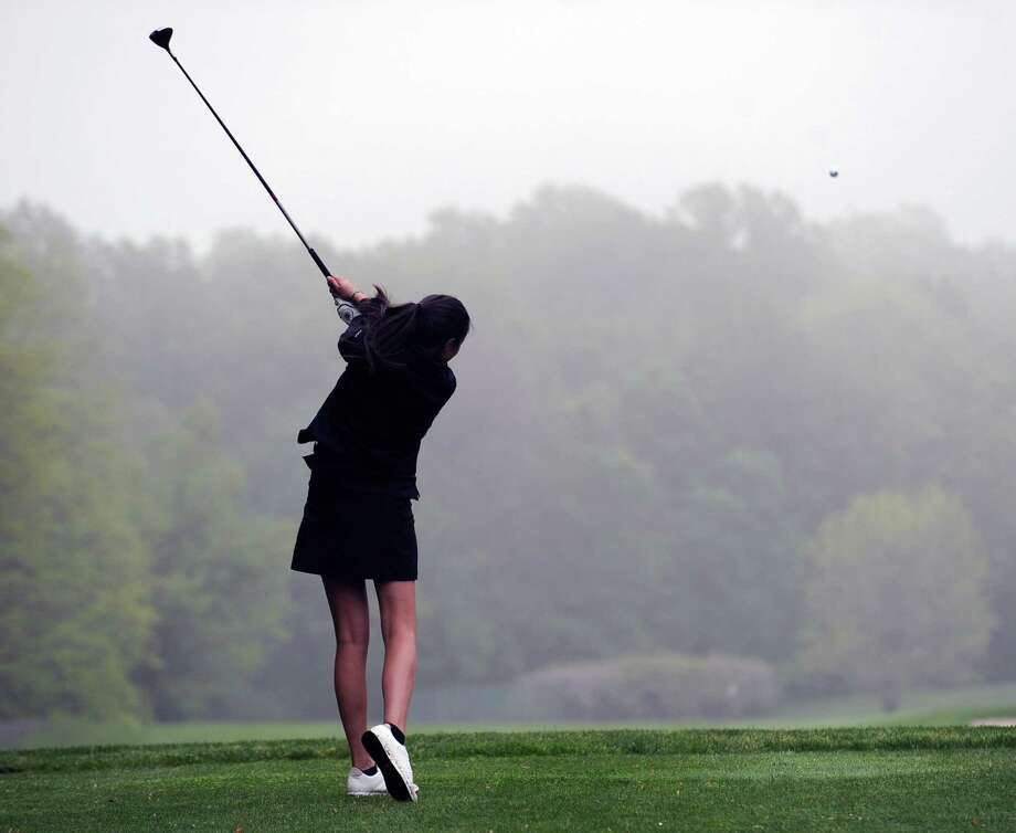Greenwich High School golfer Brooke Nethercott drives off the second tee at the Griffith E. Harris Golf Course in Greenwich last spring. Greens fees at the town-owned course will be going up under a proposal the Board of Selectmen approved Friday Photo: Bob Luckey / Greenwich Time