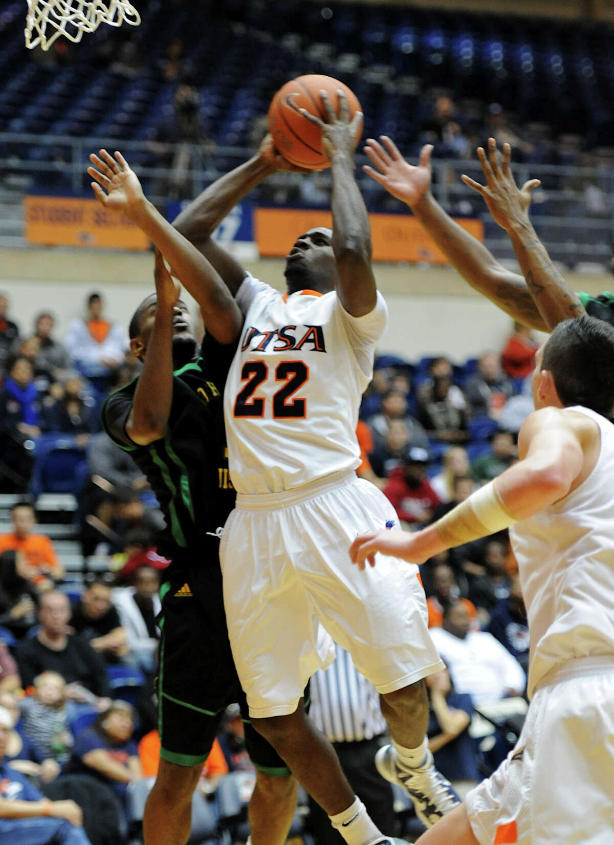 UTSA junior Kannon Burrage (22) is fouled while taking a shot during a Southland Conference mens basketball game between UTSA and Southeastern Louisiana at the UTSA Convocation Center In San Antonio, Texas on February 8, 2012. John Albright / Special to the Express-News.
