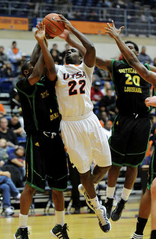 UTSA junior Kannon Burrage (22) is fouled while taking a shot during a Southland Conference mens basketball game between UTSA and Southeastern Louisiana at the UTSA Convocation Center In San Antonio, Texas on February 8, 2012. John Albright / Special to the Express-News. Photo: JOHN ALBRIGHT, Express-News / San Antonio Express-News