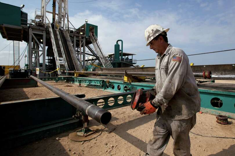 A rig worker prepares a casing that will be lowered into the well for the hydraulic fracturing proce