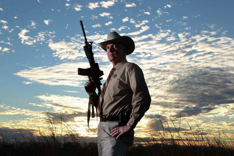 Joe W. Haralson, 62, is the longest currently serving Texas Ranger. He joined the Texas Department of Public Safety in 1972 and in 1981 became a ranger.  Unlike some law-enforcement positions, there is no age limit for being a ranger, and he can serve. Haralson, who is based in Texas City,  is head of the DPS SWAT team, as well as a sniper and a founding member of Ranger Recon, which deploys to the Texas-Mexico border. . Photo: Mayra Beltran, Houston Chronicle / © 2012 Houston Chronicle