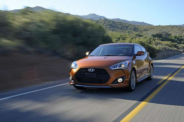 Hyundai added power to the 2013 Veloster Turbo, but the hatchback still reaches 60 mph more slowly than the Volkswagen GTI or Honda Civic Si. (Hyundai/MCT) Photo: Hyundai, McClatchy-Tribune News Service