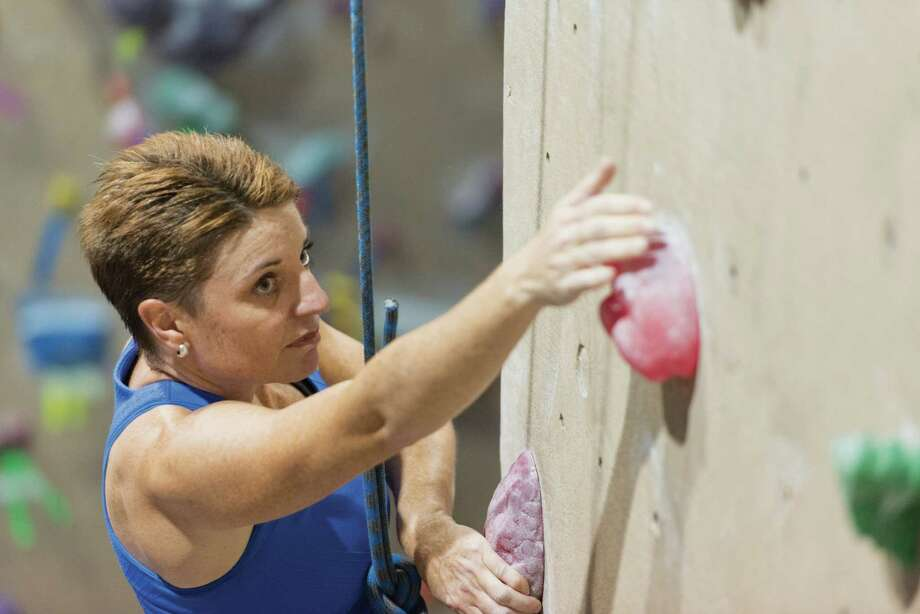 Robin Wardle negotiates a top-rope route at Carabiner's indoor climbing gym in Fairfield. Photo: Mark F. Conrad / Healthy Life