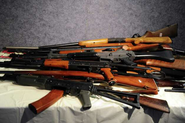 Rifles, including an AK-47, turned in during a gun buyback event at the Bridgeport Police Department's Community Services Division Friday, Dec. 28, 2012 in Bridgeport, Conn. In the wake of the tragedy in Newtown, Conn., the city raised $100,000 for the program and will offer up to $200 value for a working handgun, $75 for rifles and higher amounts for assault-type rifles.  The buy back will continue every Saturday until the city gives out all of the funds which includes an additional $10,000 in gift cards from the Food Bazaar grocery store. Photo: Autumn Driscoll / Connecticut Post