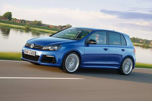 A Volkswagen AG Golf R high performance automobile is seen in this undated handout photo released to the media on Monday, Sept. 26, 2011. Volkswagen AG is expanding its offering of souped-up VW models, which can cost double the price of the base version, to boost the brand s image and margins. Photo: Volkswagen Ag, VOLKSWAGEN