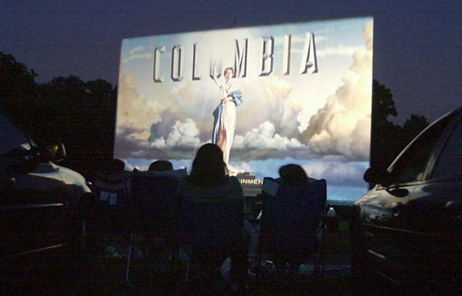 Drive-in movie theaters must decide whether to pay up to $70,000 for digital projectors. Photo: Chris Gardner, AP