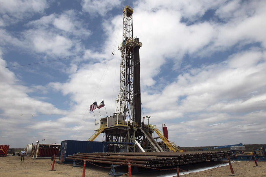 Drilling rigs like this one in McMullen county, Texas near Tilden are are a common sight as the Eagle Ford Shale dominated business activity in 2012. Photo: JOHN DAVENPORT, SAN ANTONIO EXPRESS-NEWS / SAN ANTONIO EXPRESS-NEWS