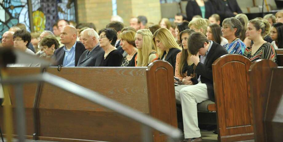 "Members of the Leger family listen as the mass progressed. A Memorial Service was held for KFDM veteran journalist and anchorman William ""Bill"" Leger Jr. Friday December 28, 2012, at Saint Jude Thaddeus Catholic Church in Beaumont. He was laid to rest earlier in the week in his hometown of Kinder Louisiana.  Dave Ryan/The Enterprise Photo: Dave Ryan"