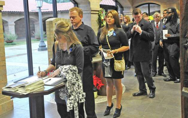 "A line waits to sign one of two guest books set up in the lobby area of the santuary.  A Memorial Service was held for KFDM veteran journalist and anchorman William ""Bill"" Leger Jr. Friday December 28, 2012, at Saint Jude Thaddeus Catholic Church in Beaumont. He was laid to rest earlier in the week in his hometown of Kinder Louisiana.  Dave Ryan/The Enterprise Photo: Dave Ryan"