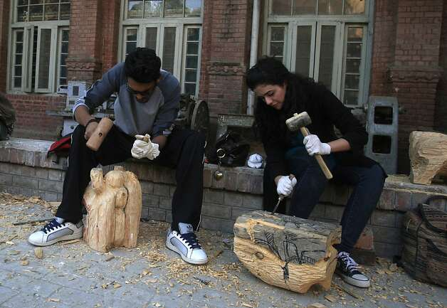 Students carve wooden statues at the National College of Arts in Lahore, Pakistan. Suggestive paintings of Muslim clerics could lead to blasphemy charges for the artist and school officials. Photo: K.M. Chaudary, Associated Press