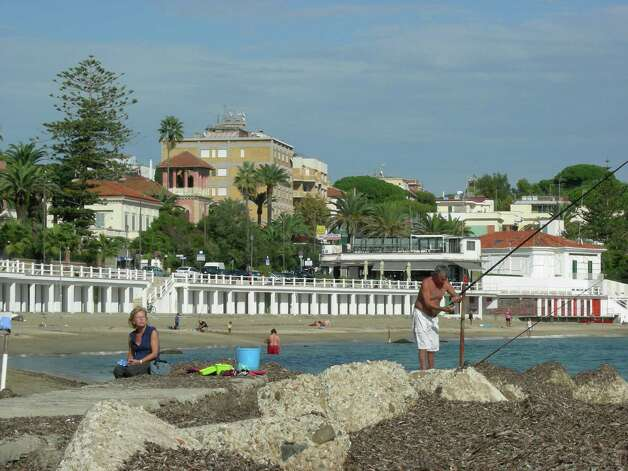The beach in Santa Marinella welcomes fishermen, swimmers and people who just want to relax on the sand. Photo: Stefanie Arias, San Antonio Express-News / San Antonio Express-News