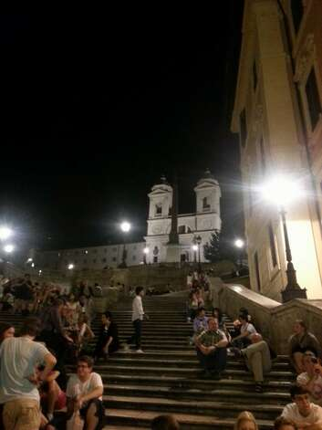 People-watchers lounge on the Spanish Steps at night. Photo: Michelle Mondo, San Antonio Express-News / San Antonio Express-News