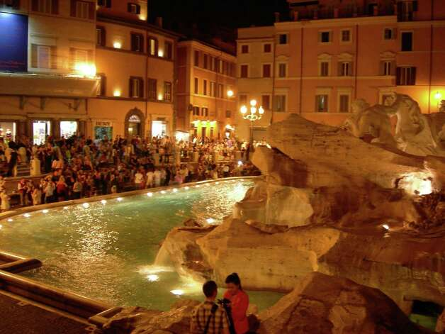 Revelers gather in front of the Trevi Fountain. The night crowd is much smaller than the number of daytime visitors. Photo: Stefanie Arias, San Antonio Express-News / San Antonio Express-News