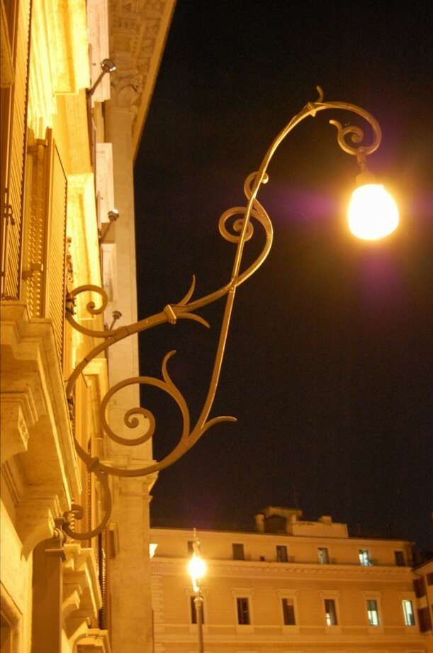 Take a night walk to see the sites of Rome glow in light cast from ornate street lamps. Photo: Michelle Mondo, San Antonio Express-News / San Antonio Express-News