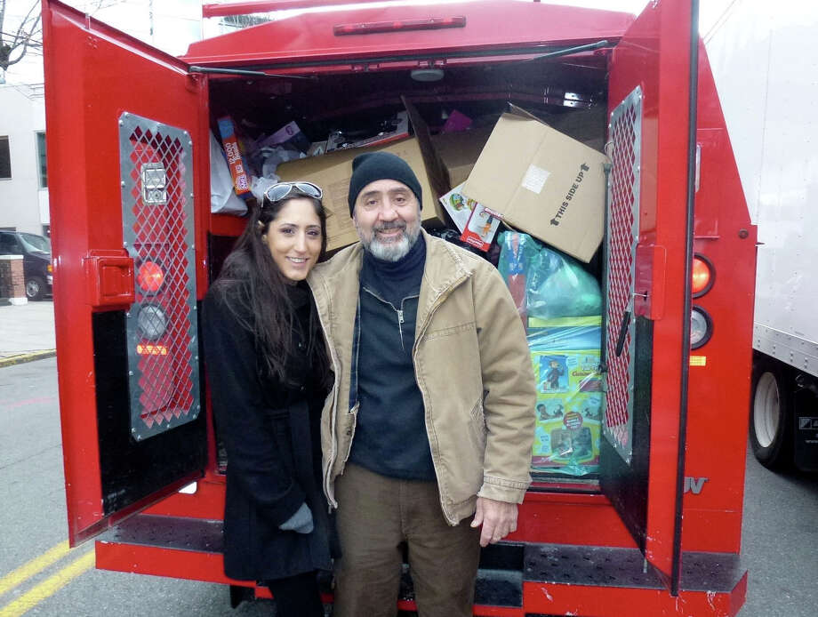 Casey Sorbara with her dad, Len,  with a truckload Christmas toys she collected for Sandy victims in the Rockaways NY.   Casey Sorbara is a former girls basketball player at Trinity Catholic High School in Stamford, Conn. Photo: Contributed Photo / Stamford Advocate Contributed