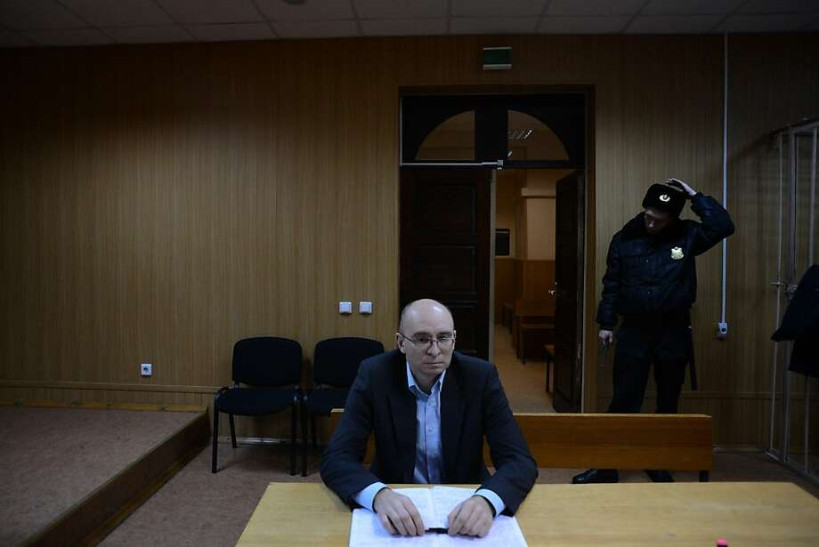 Dmitry Kratov, accused of causing the death of lawyer Sergei Magnitsky, sits during his trial. Photo: Kirill Kudryavtsev, AFP/Getty Images