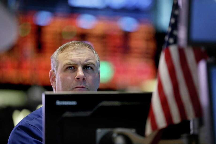A trader works on the floor at the New York Stock Exchange in New York, Friday, Dec. 28, 2012. Stocks were heading lower Friday, for a fifth day, on concern that Washington lawmakers will fail to reach a budget deal before a year-end deadline. (AP Photo/Seth Wenig) Photo: Seth Wenig