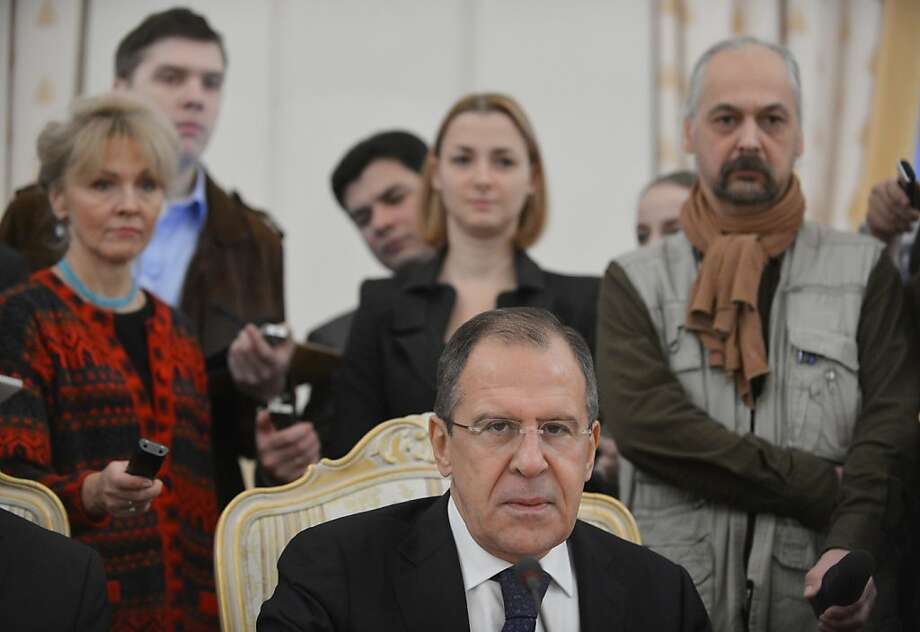 Russia's Foreign Minister Sergei Lavrov is circled with journalists in Moscow on December 28, 2012, as he meets his visiting Egypt counterpart Mohamed Amr on the Syrian crisis. AFP PHOTO / NATALIA KOLESNIKOVANATALIA KOLESNIKOVA/AFP/Getty Images Photo: Natalia Kolesnikova, AFP/Getty Images