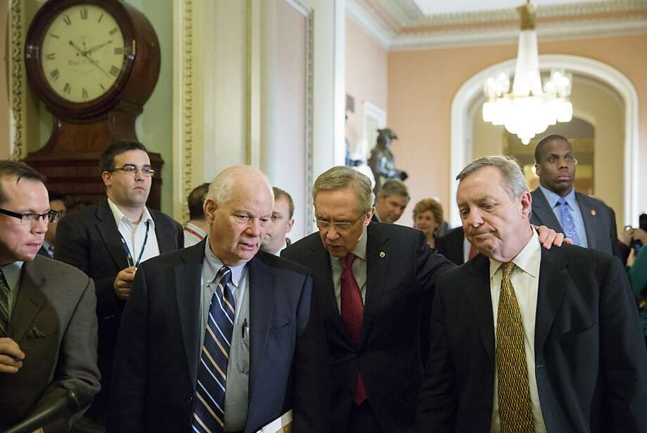 "WASHINGTON, DC - DECEMBER 28:  Majority Leader Harry Reid (D-NV) (C) is flanked Sen. Ben Cardin (D-MD) (L) and Sen. Dick Durbin (D-IL) (R) as they leave a caucus meeting and head toward the Senate floor on Capitol Hill on December 28, 2012 in Washington, DC. Senators were back on Capitol Hill on Friday to try to deal with the ""fiscal cliff"" before the year-end deadline.  (Photo by Drew Angerer/Getty Images) Photo: Drew Angerer, Getty Images"