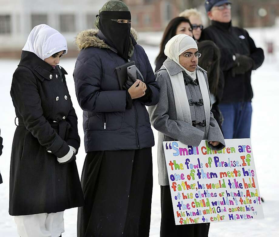Members of the Islamic Society of Western Connecticut join a prayer vigil for victims. Photo: Carol Kaliff, Associated Press