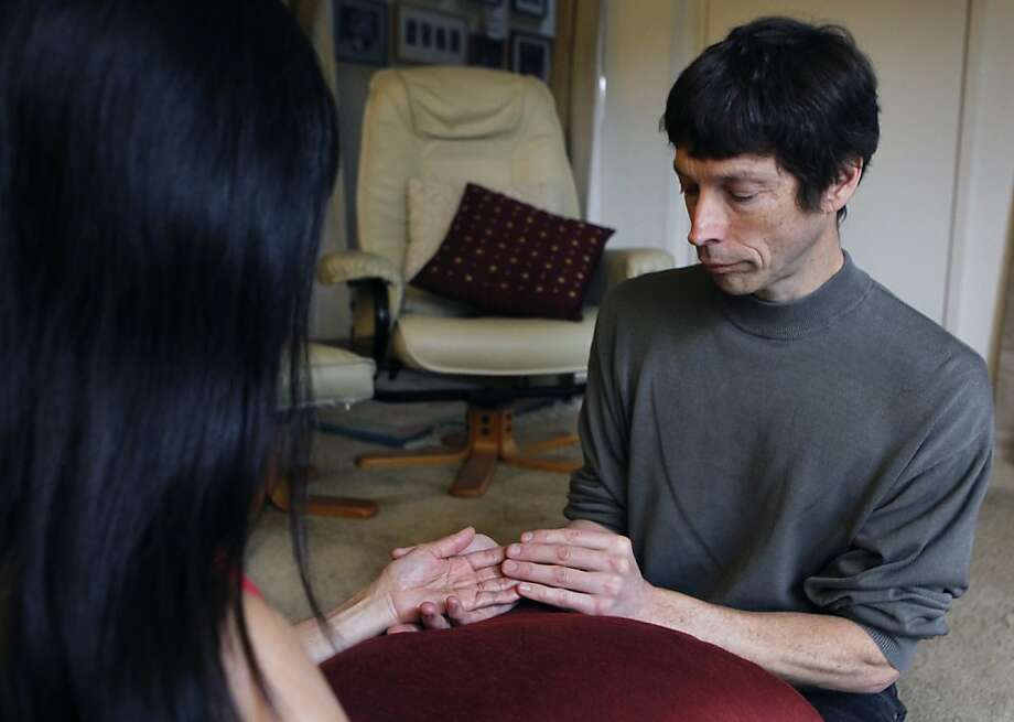 Andrew Heartman demonstrates a sensate focus exercise, that he uses as a surrogate partner for his clients, in Union City, Calif. on Friday, Dec. 28, 2012. Photo: Paul Chinn, The Chronicle