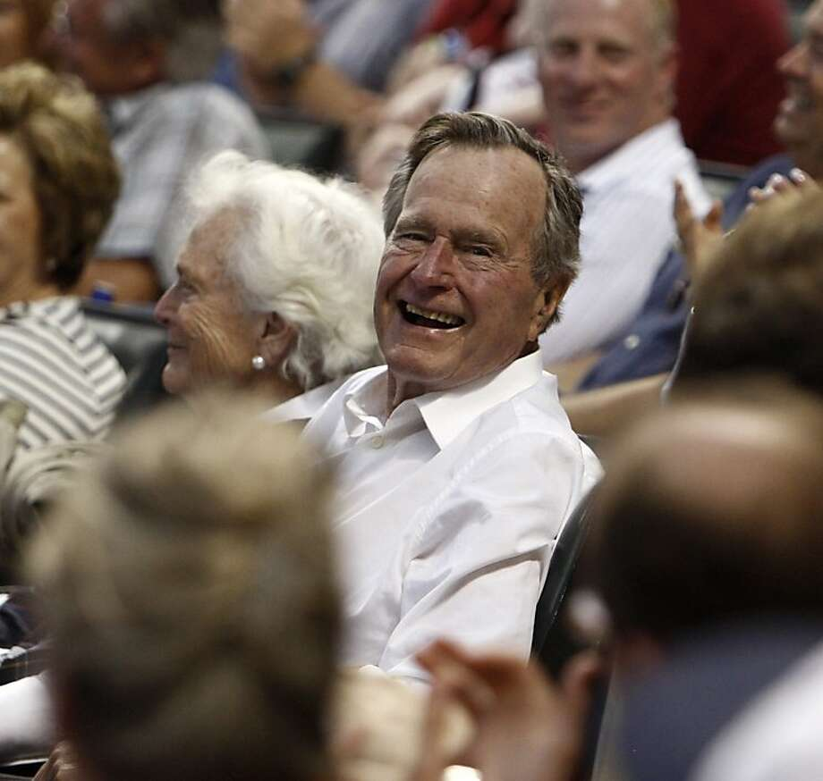 FILE - NOVEMBER 29: Former U.S. President George H.W. Bush has been hospitalized with bronchitis in Houston, Texas for six days, his spokesman said on November 29, 2012. HOUSTON - APRIL 30:  Former President George H.W. Bush gives a smile to crowd after he was on the video screen during a baseball game between the Milwauakee Brewers and Houston Astros at Minute Maid Park on April 30, 2011 in Houston, Texas.  (Photo by Bob Levey/Getty Images) Photo: Bob Levey, Getty Images