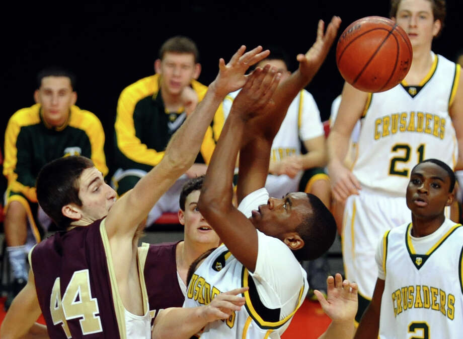 Trinity Catholic's #5 Brandon Wheeler looses control of the ball as Monsignor Farrell's #44 Thomas Vazzana defends the basket, during Northeast Christmas Classic basketball tournament at Webster Bank Arena in Bridgeport, Conn. on Frday December 28, 2012. Photo: Christian Abraham / Connecticut Post