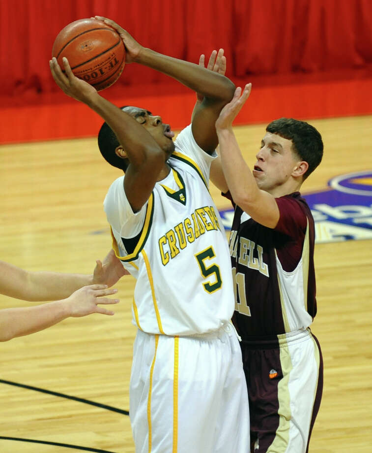 Trinity Catholic's #5 Brandon Wheeler gets pressure from Monsignor Farrell's #11 Connor Nicholson, during Northeast Christmas Classic basketball tournament action against Monsignor Farrell at Webster Bank Arena in Bridgeport, Conn. on Frday December 28, 2012. During this game Casimir celebrated scoring his 1000th point. Photo: Christian Abraham / Connecticut Post
