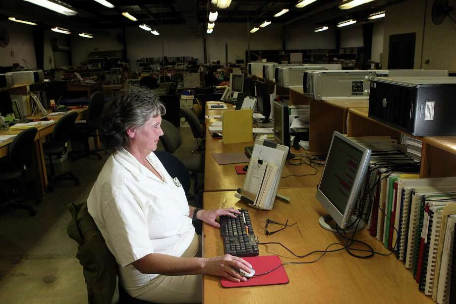 "Connie Stone, 50, who is serving 40 years for solicitation of capital murder, translates a book into Braille using a computer program at the Braille facility. Stone, a former parole officer and criminal justice major, said ""I just didn't want to sit here, I wanted to give back,"" she said. ""I like that i'm providing training so someone could keep on learning. I would like to be an advocate for this when I get out."" Photo: Johnny Hanson, Houston Chronicle / © 2012  Houston Chronicle"