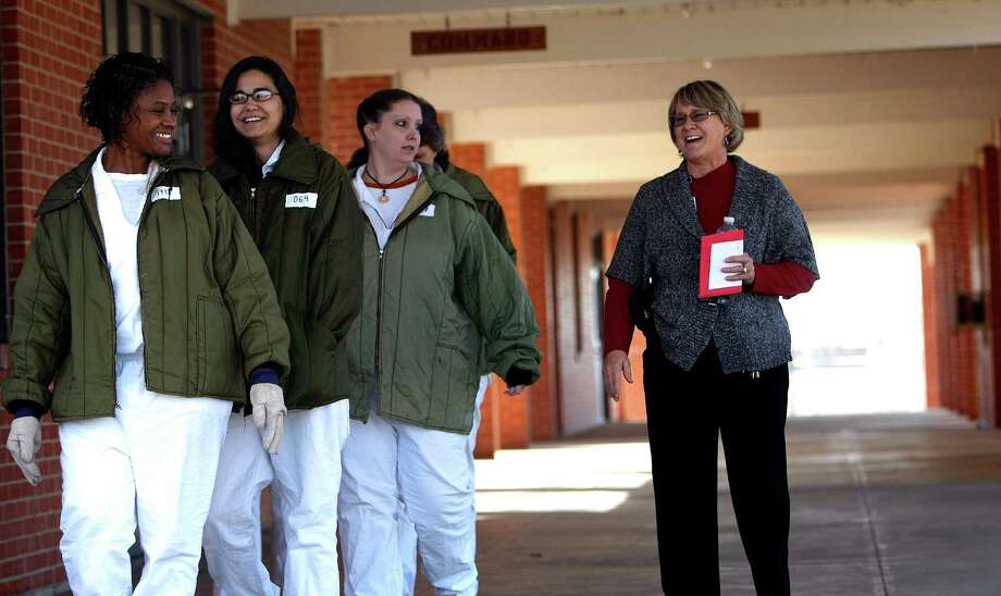 Delores Billman, right, plant manager at the Mountain View Womens Prison, escorts a group of prisoners to work. Photo: Johnny Hanson, Houston Chronicle / © 2012  Houston Chronicle