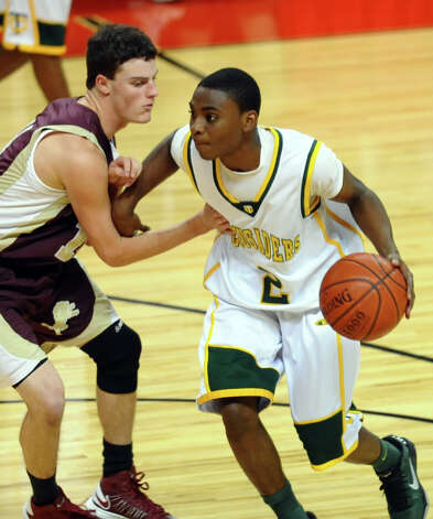 Trinity Catholic's #2 Schadrac Casimir, during Northeast Christmas Classic basketball tournament action against Monsignor Farrell at Webster Bank Arena in Bridgeport, Conn. on Frday December 28, 2012. Photo: Christian Abraham / Connecticut Post