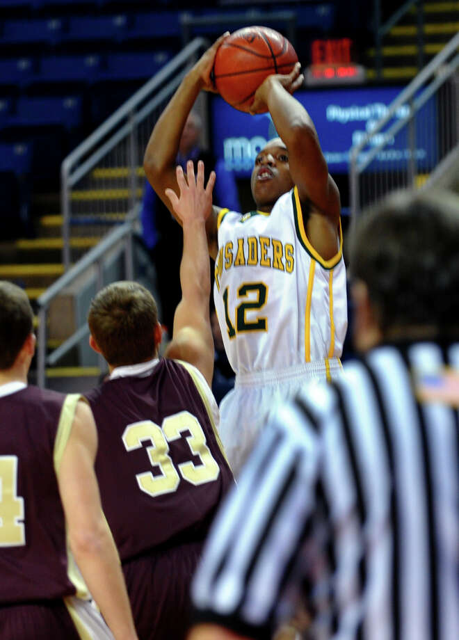 Northeast Christmas Classic basketball tournament action between Trinity Catholic and Monsignor Farrell at Webster Bank Arena in Bridgeport, Conn. on Frday December 28, 2012. Photo: Christian Abraham / Connecticut Post