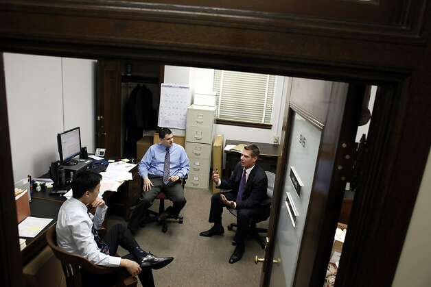 Swalwell catches up with fellow deputy district attorneys Danny Lau (left) and Luis Marin in Marin's office Dec. 5. Swalwell will be sworn in Thursday as a member of Congress after defeating Pete Stark. Photo: Carlos Avila Gonzalez, The Chronicle