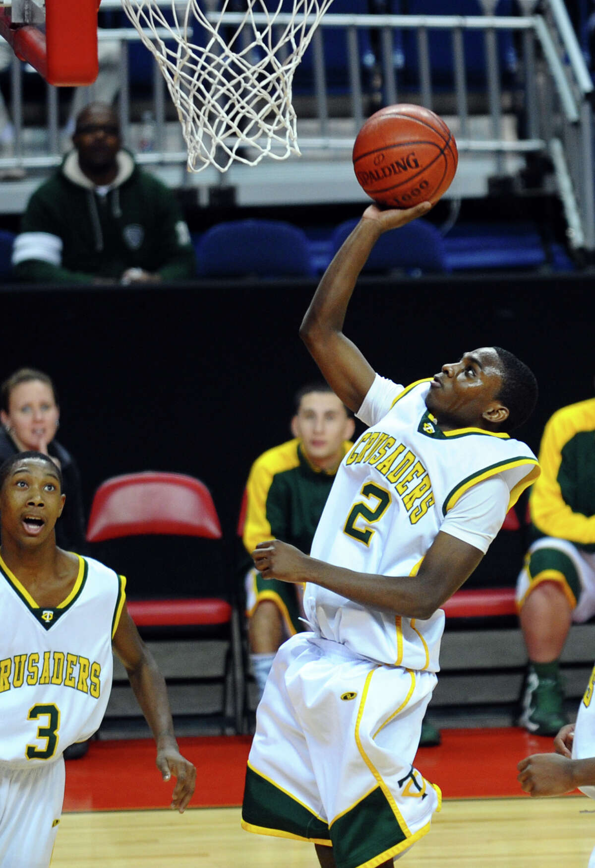 Trinity Catholic's #2 Schadrac Casimir lays up for two, during Northeast Christmas Classic basketball tournament action against Monsignor Farrell at Webster bank Arena in Bridgeport, Conn. on Frday December 28, 2012. During this game Casimir celebrated scoring his 1000th point.