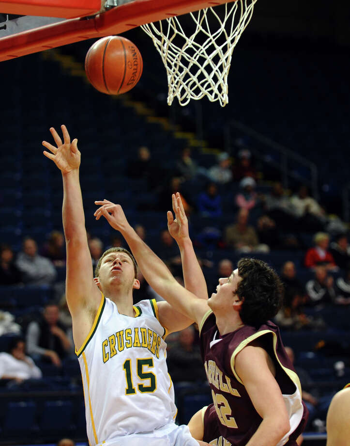 Trinity Catholic's #15 Patrick Keneally sends up a shot as Monsignor Farrell's #42 Brian O'Sullivan defends, during Northeast Christmas Classic basketball tournament at Webster Bank Arena in Bridgeport, Conn. on Frday December 28, 2012. Photo: Christian Abraham / Connecticut Post