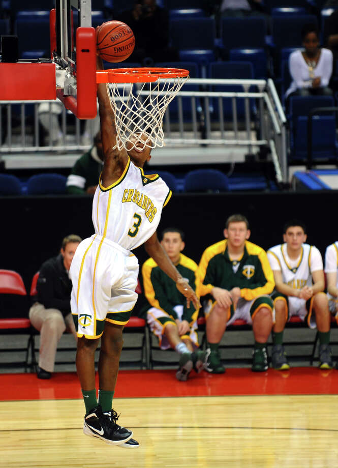 Trinity Catholic's #3 Tremaine Fraiser, during Northeast Christmas Classic basketball tournament action against Monsignor Farrell at Webster Bank Arena in Bridgeport, Conn. on Frday December 28, 2012. Photo: Christian Abraham / Connecticut Post