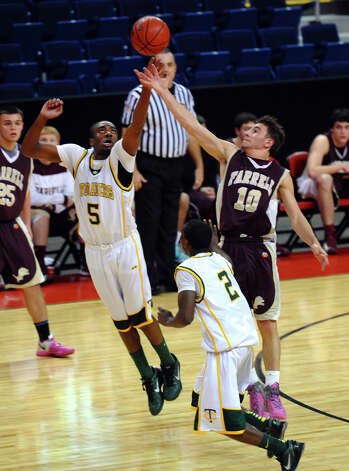 Trinity Catholic's #5 Brandon Wheeler, left, and Monsignor Farrell's #10 John Orsino reach for a loose ball, during Northeast Christmas Classic basketball tournament action at Webster Bank Arena in Bridgeport, Conn. on Frday December 28, 2012. Photo: Christian Abraham / Connecticut Post
