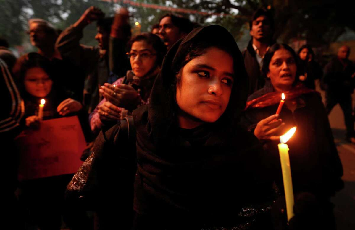 FILE - In this Dec. 26, 2012 file photo, Indians participate in a candle light vigil to seek a quick recovery of the young victim of the recent brutal gang-rape in a bus in New Delhi, India. A statement by Singapore?'s Mount Elizabeth hospital, where the 23-year-old victim was being treated, said she died Saturday, Dec. 29, 2012. (AP Photo/Saurabh Das, File)