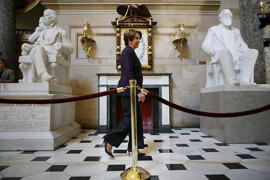 "WASHINGTON, DC - DECEMBER 07:  House Minority Leader Nancy Pelosi (D-CA) walks past sculptures of Alexander Hamilton Stephens (L) and Brigham Young as she arrives for a news conference in Statuary Hall in the U.S. Capitol December 7, 2012 in Washington, DC. Pelosi called on the House Republicans to help pass the Senate's version of the tax bill and help avert the ""fiscal cliff.""  (Photo by Chip Somodevilla/Getty Images) Photo: Chip Somodevilla, Getty Images"
